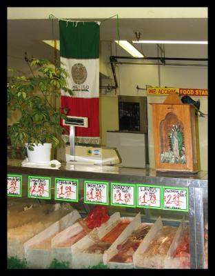 Virgin at the meat counter at El Mercado ELA.