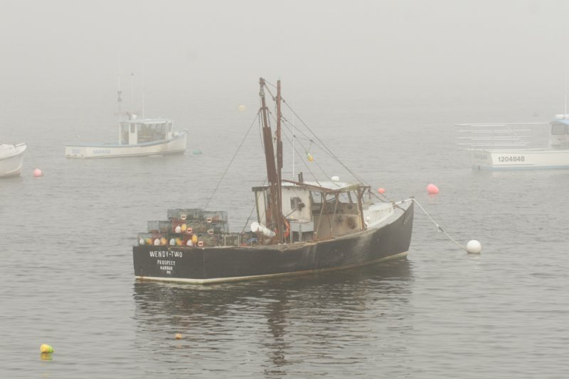 Lobster boat in the fog