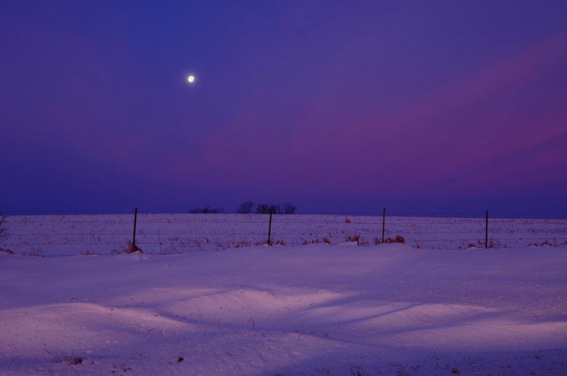 Waning Gibbous Moon over Snow Landscape