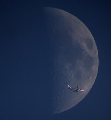 American Airline Plane in front of Moon