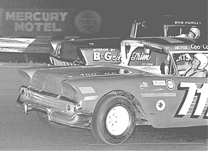 Driver Coo Coo Marlin battles the car driven by Bob Hunley 1964