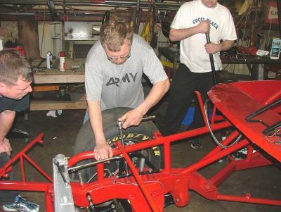 Tony Formosa Jr adjusting chassis