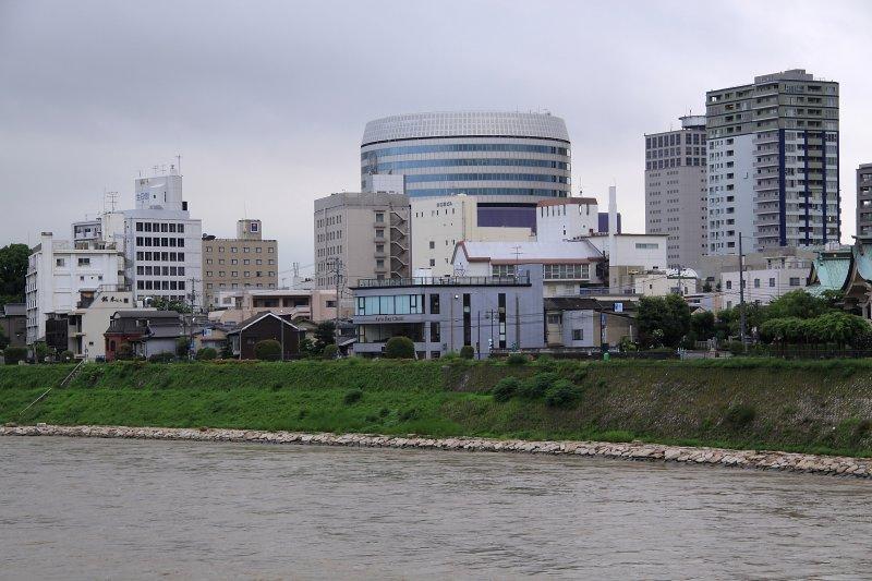 Modern Okayama skyline across the Asahi-gawa