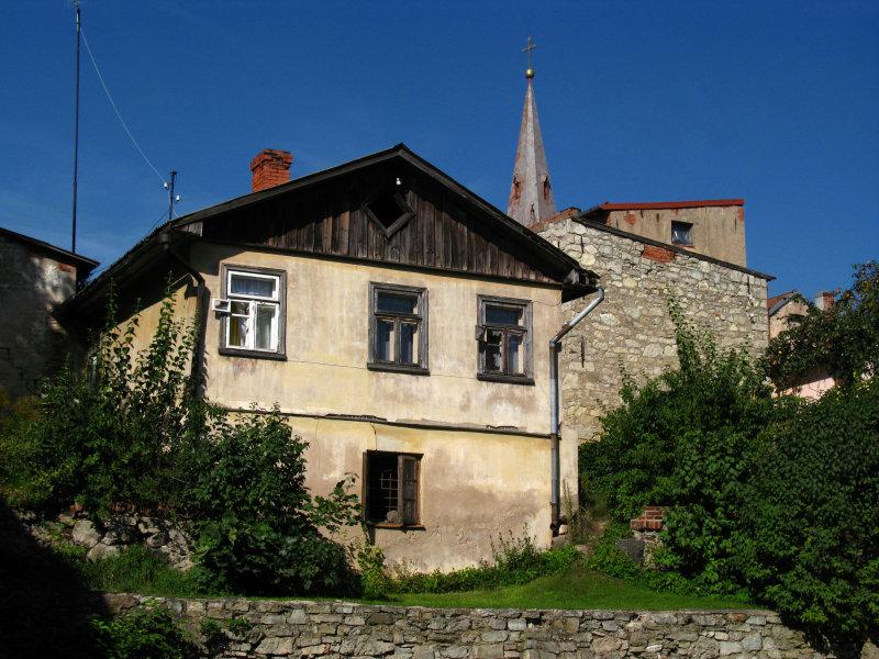 Behind an old house on Valņu iela