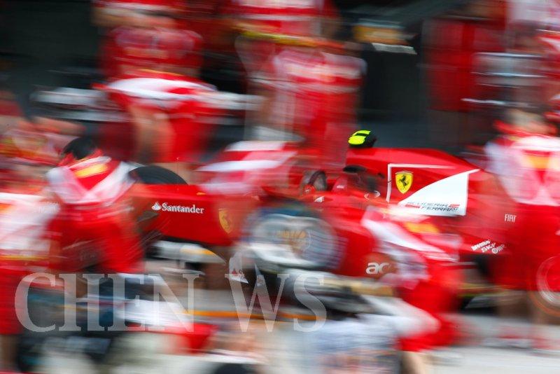Ferraris crew practices pit-stop