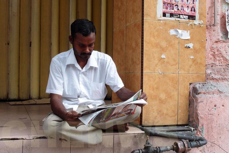Reading newspapers 20110522-082525-023.jpg