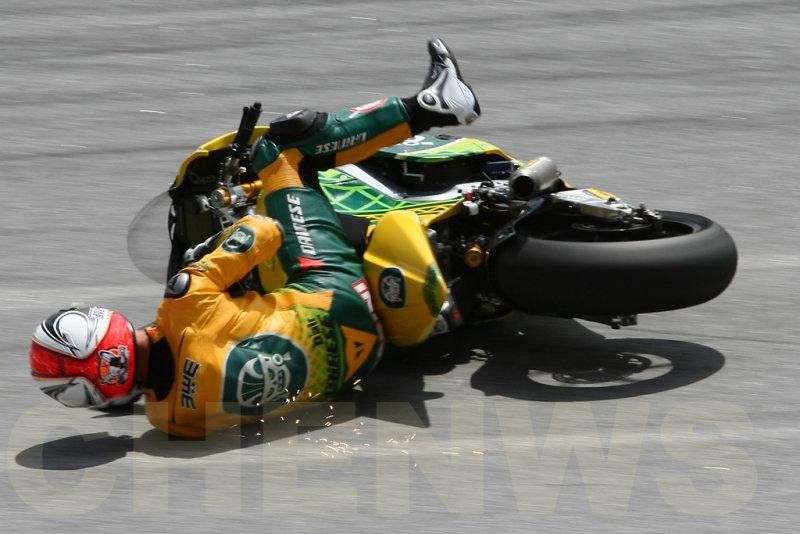 Mattia Pasini falls during practice at the Malaysian Motocycle GP 2011