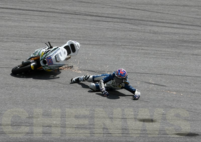 Anthony West (Moto2) falls during practice at the Malaysian Motocycle GP 2011