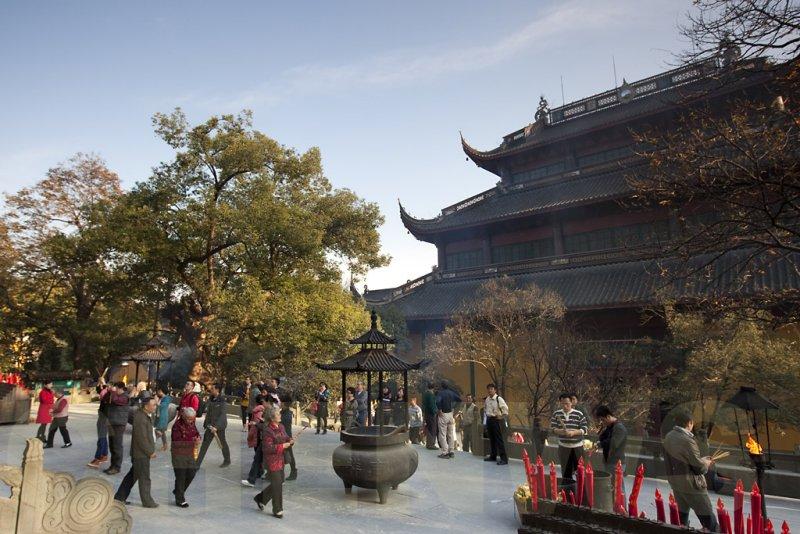 Devotees praying outside the Hall of Medicine Buddha.
