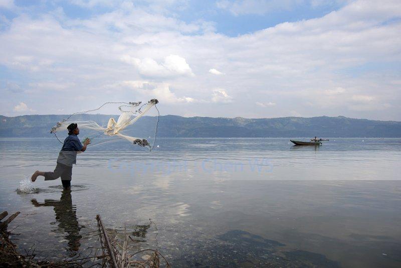 Net fishing on the Lake Singkarak, Indonesia