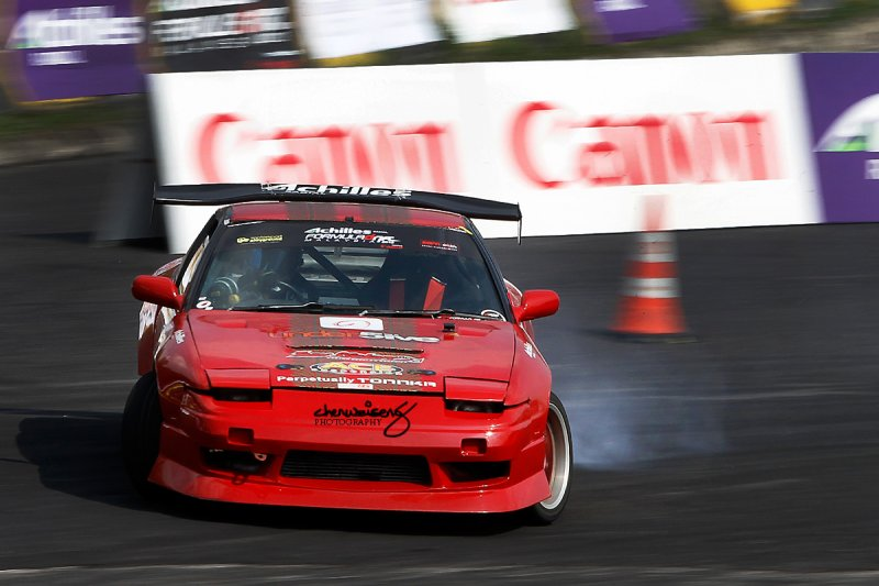 Rhenadi Arinton (Rowdy) from Indonesia driving a red Nissan Silvia 180SX for team Driftbash