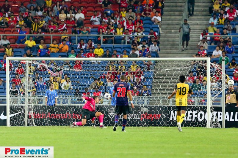 Vito Mannone fails to stop Azmi Muslim scoring Malaysias first goal