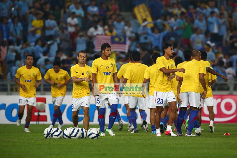 Malaysian XI warming up