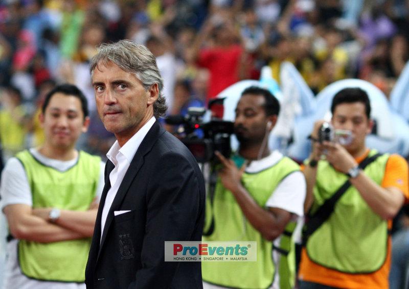 Roberto Mancini enters the stadium