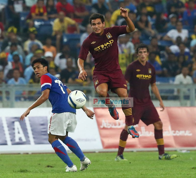 Marcos Lopes leaps to intercept M. Shakir Shaari