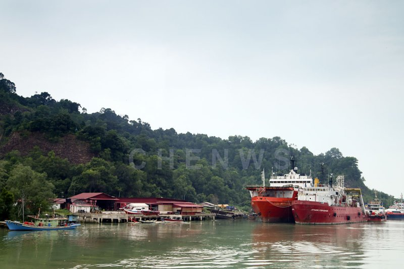 Boats working in the offshore petroleum industry moor at the mouth of the river, Terengganu