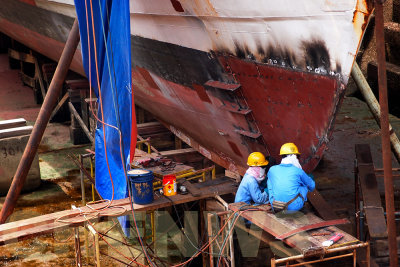 Workers at the dry dock