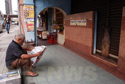Reading newspapers 20110522-083142-040.jpg