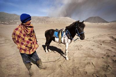 A Tengger and his horse inside the caldera.
