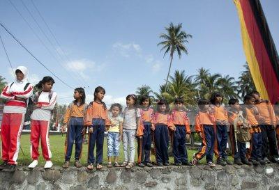 School children awaiting the opening ceremony