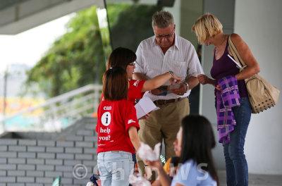 Volunteers helping guests