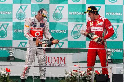 Lewis Hamilton and Fernando Alonso celebrate on the podium