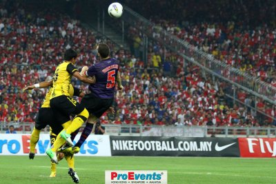 Thomas Vermaelen (5) attempts a header