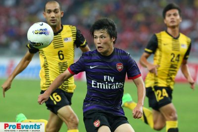 Ryo Miyachi eyes the ball