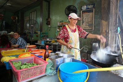 Cook in a restaurant in Chinatown, Kuala Terengganu
