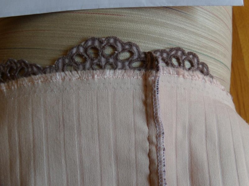 Eyelet Knit Skirt Seam Detail. Lining treated as one with Fashion Fabric.