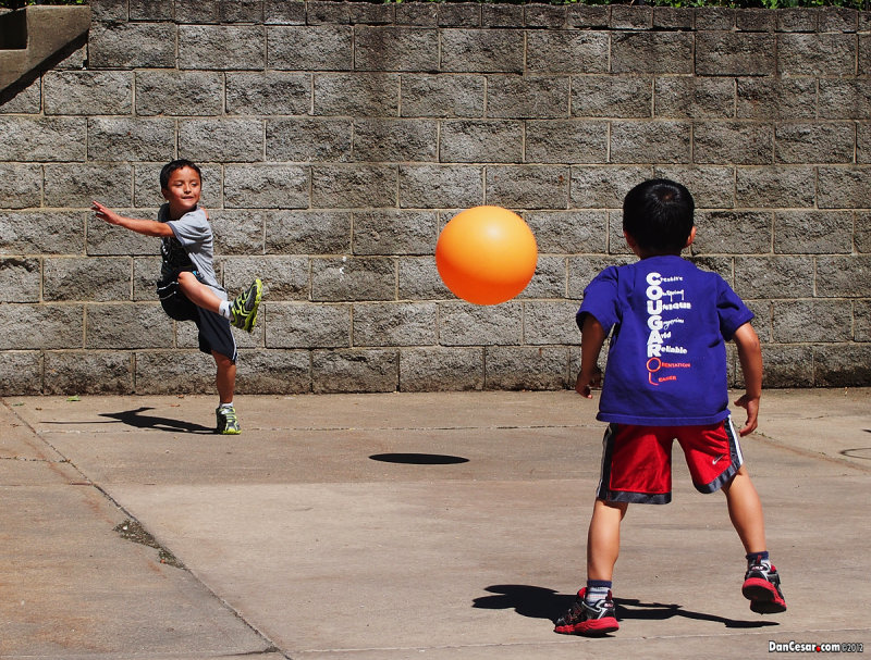 A game of kickball in the driveway