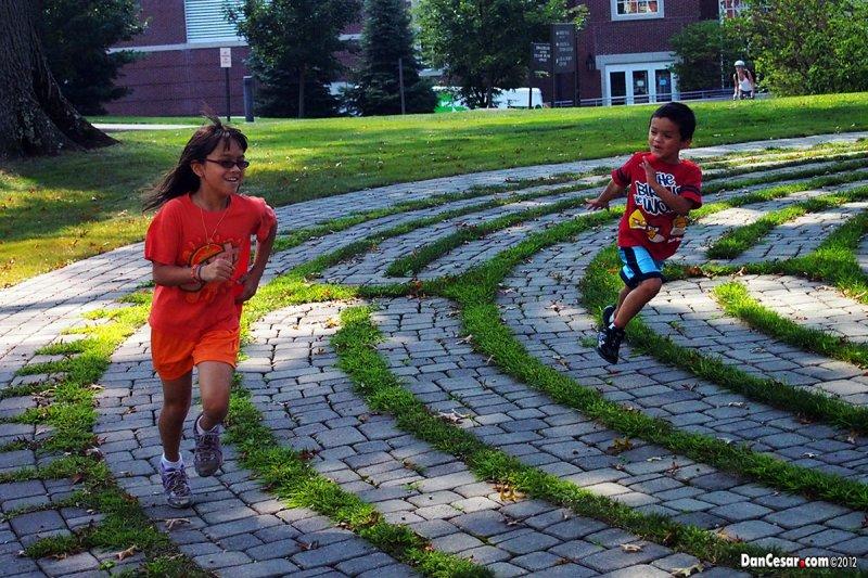 Emma & Spencer running on a labyrinth
