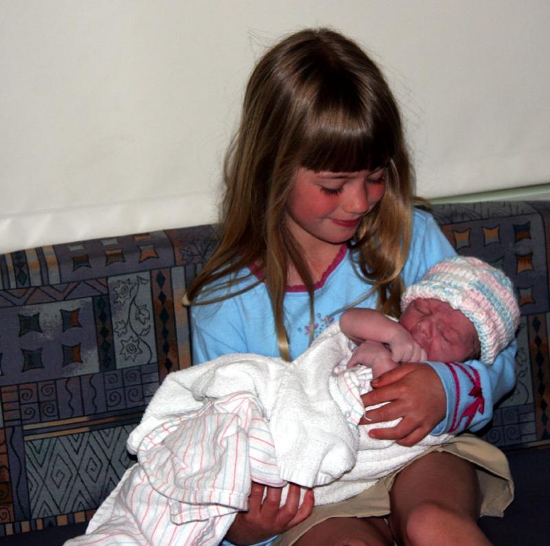 Sister Brenna Holding James in Blue Cap