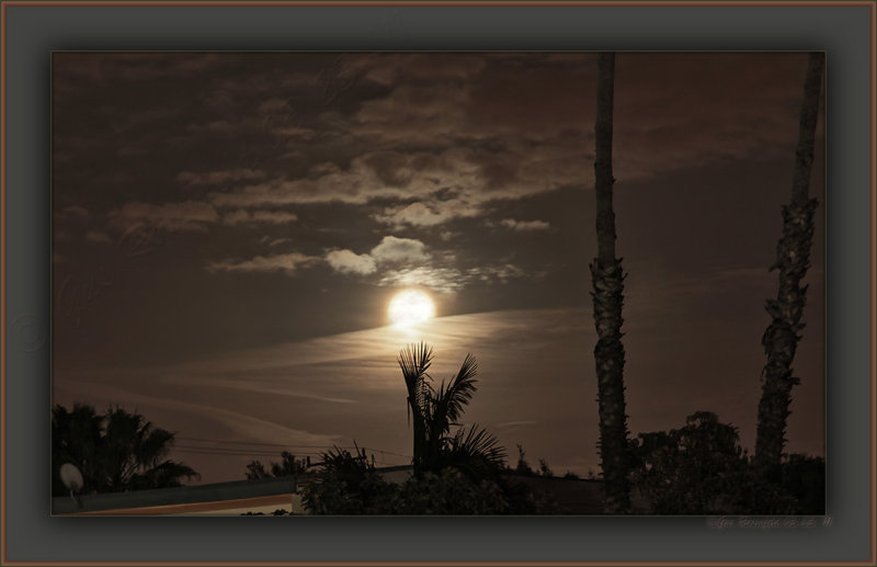 2011 Perigee Moons Brief Appearance Through Clouds