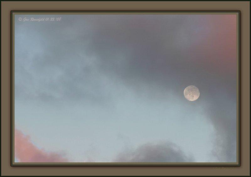 A Passing Full Moon Vignette At Sunset