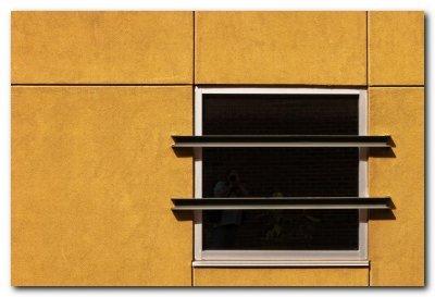 Window In A Yellow Wall