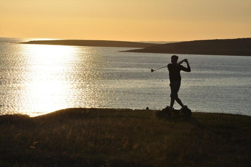 Golfing into the sunset I