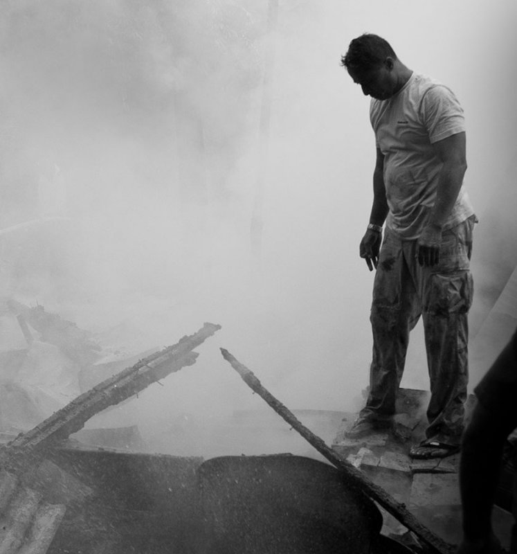 An exhausted fire fighter in the aftermath of the fire.  IMG_2029.jpg