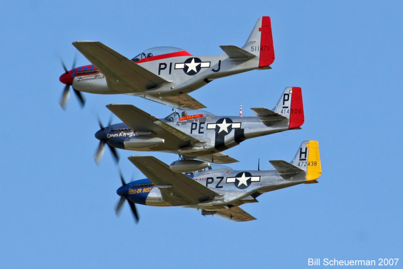 Flight of 3 P-51s
