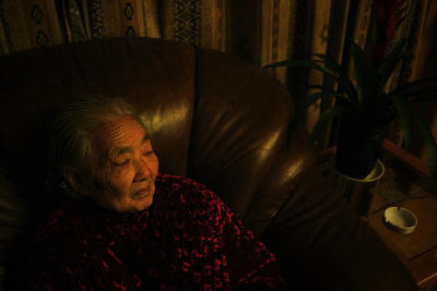 Grandma sits alone, thinking of a friend who is ill, and cannot be with her.