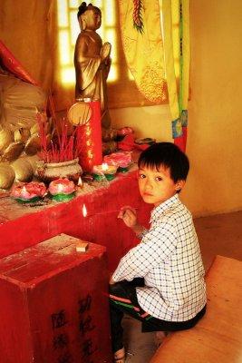 Praying boySecure, Anhui Province, China, 2006