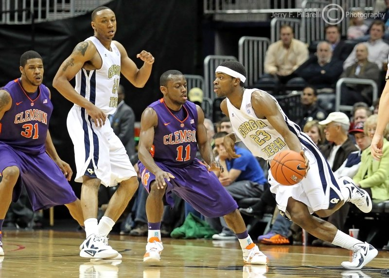 Jackets G Brandon Reed makes a move as teammate F Holsey sets a pick on Tigers G Andre Young