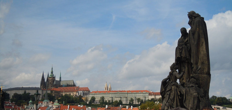 Sculpture on Charles Bridge and Prague Castle in the distance