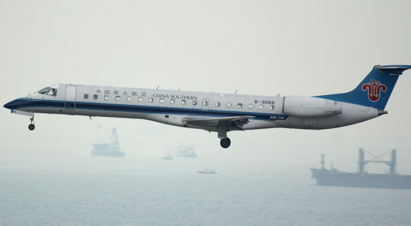 An almost empty China Southern E-145 arriving in HKG