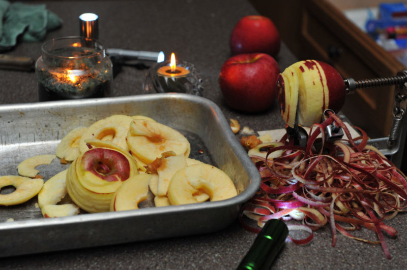 Peeling apples by candle-light during power outage
