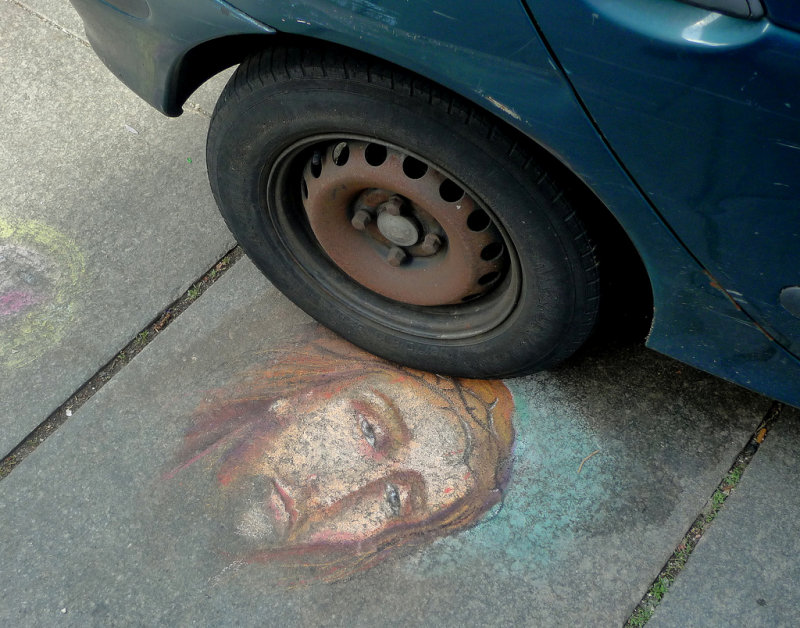 Contrast between a car and Jesus
