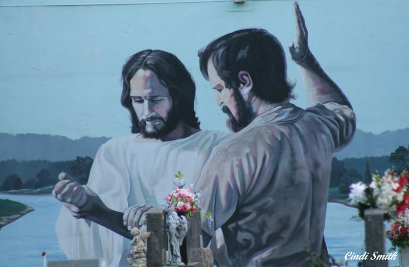 PAINTING ON A WALL IN THE CEMETERY