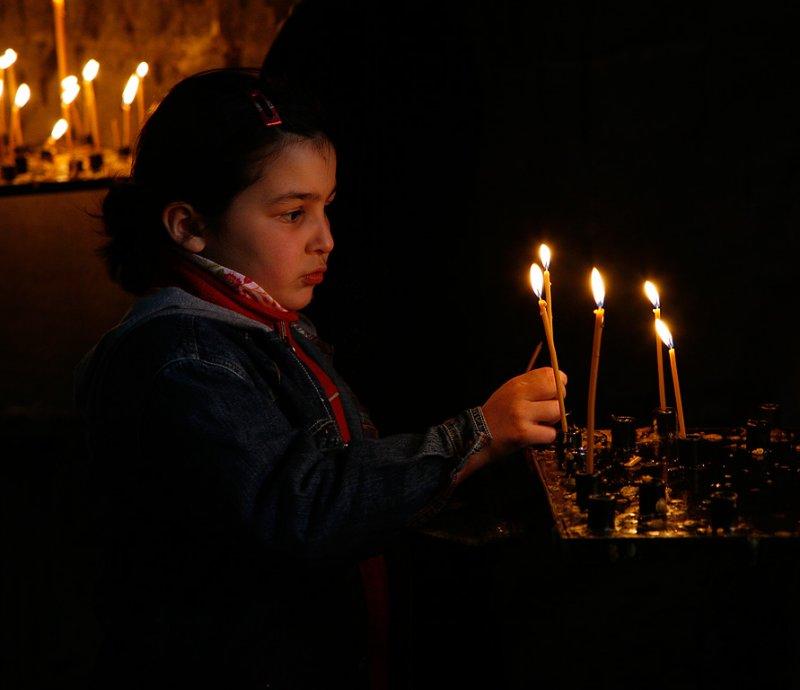 Child lighting candles in Dzvan