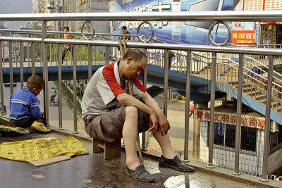 China old man begging