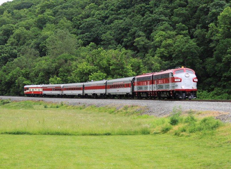The R.J. Corman Derby train rolls down Benson valley in a typical Derby day rain